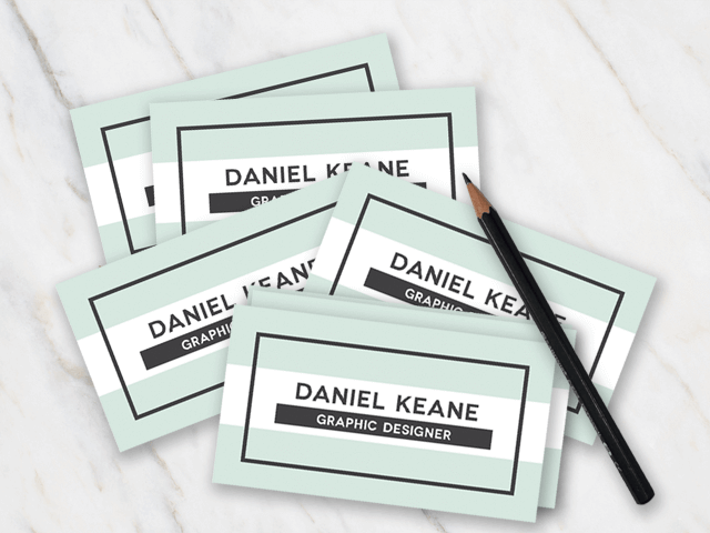 Business card with mint green white and black colors