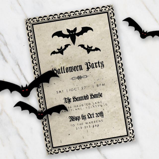 Halloween invitation with bats on parchment looking paper