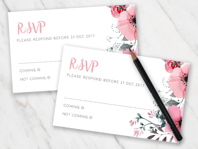 Marble table with wedding rsvp templates with pink flower elements
